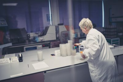 Lady in Scientific Lab offering Flow Cytometry Services
